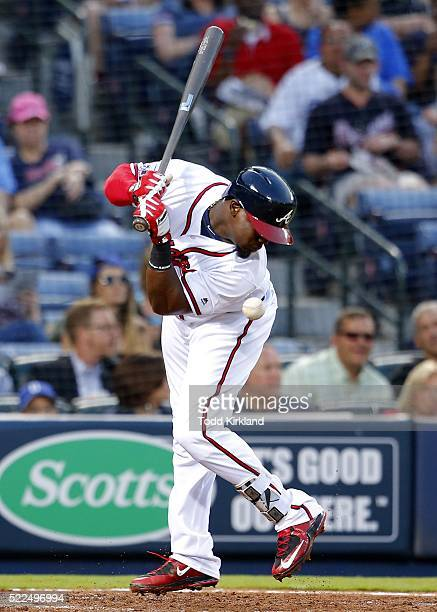 Adonis Garcia of the Atlanta Braves is hit by a pitch in the third inning of the game against the Los Angeles Dodgers on April 19 2016 at Turner...