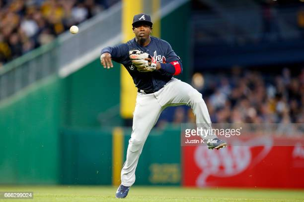 Adonis Garcia of the Atlanta Braves makes a throwing error in the second inning against the Pittsburgh Pirates at PNC Park on April 8 2017 in...