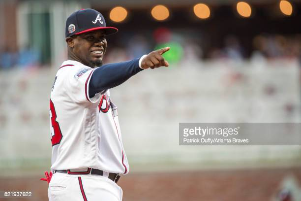 Adonis Garcia of the Atlanta Braves points during the game against the San Diego Padres at SunTrust Park on April 17 2017 in Atlanta Georgia The...