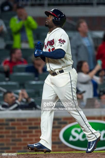 Adonis Garcia of the Atlanta Braves scores against the St Louis Cardinals at SunTrust Park on May 6 2017 in Atlanta Georgia The Cardinals won the...