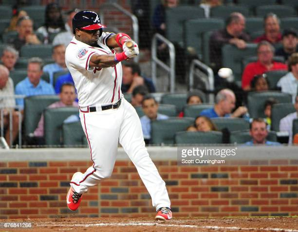 Adonis Garcia of the Atlanta Braves singles to score a seventh inning run against the New York Mets at SunTrust Park on May 2 2017 in Atlanta Georgia