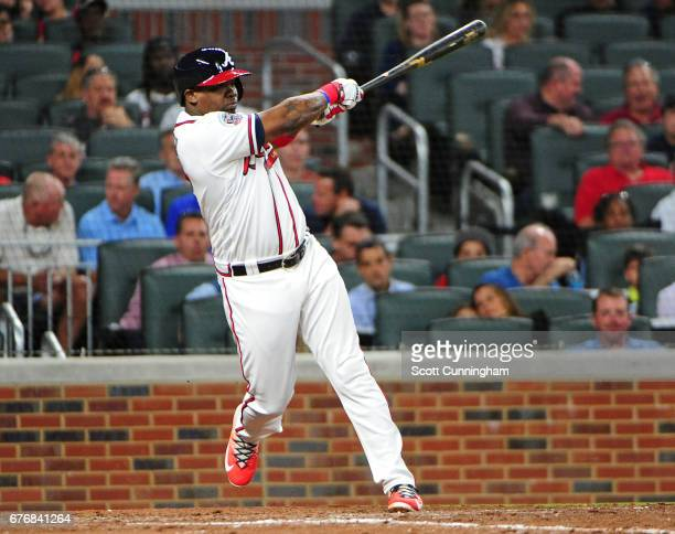 Adonis Garcia of the Atlanta Braves singles to score a seventhinning run against the New York Mets at SunTrust Park on May 2 2017 in Atlanta Georgia