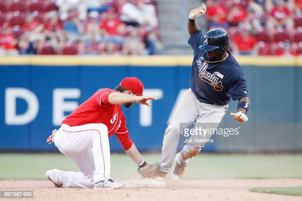 Adonis Garcia of the Atlanta Braves steals second base ahead of the throw to Jose Peraza of the Cincinnati Reds in the 12th inning of a game at Great...
