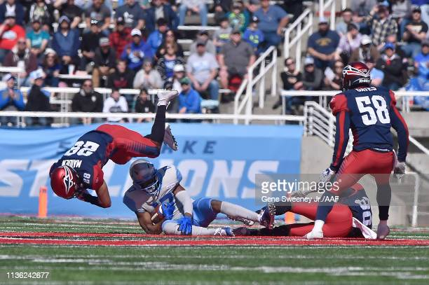 Adonis Jennings of the Salt Lake Stallions catches a first down against Brandon Maiden of the Memphis Express in the first half at Rice Eccles...