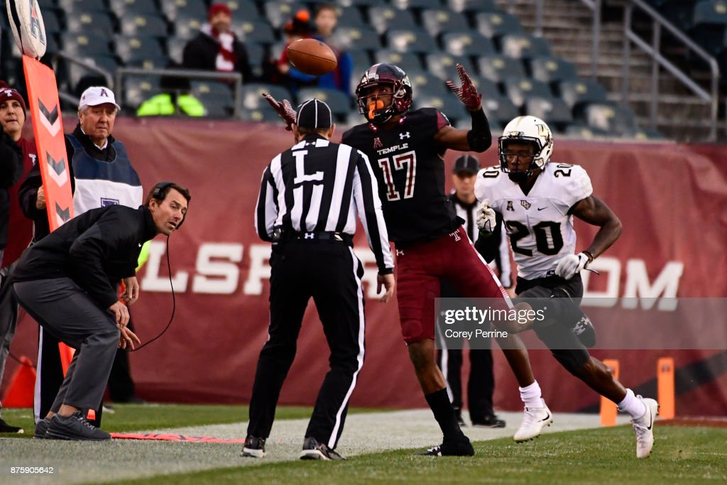 Adonis Jennings #17 of the Temple Owls eyes a dropped pass as Brandon Moore #20 of the UCF Knights looks on at Lincoln Financial Field on November 18, 2017 in Philadelphia, Pennsylvania. UCF defeated Temple 45-19.