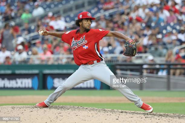 Adonis Medina of the World Team pitches in the seventh inning against the US Team during the SiriusXM AllStar Futures Game at Nationals Park on July...
