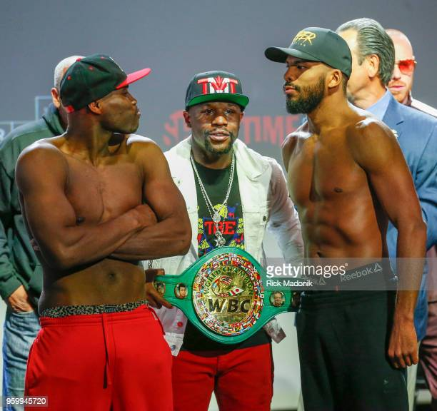 Adonis Stevenson and Badou Jack face off after the weigh in as Floyd Money Mayweather one of the promoters of the fight holds the belt Boxers Adonis...
