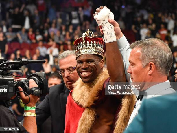 Adonis Stevenson celebrates after defeating Andrzej Fonfara during the WBC light heavyweight world championship match at the Bell Centre on June 3...