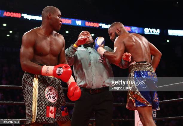 Adonis Stevenson looks on as Referee Ian JohnLewis takes a punch from Badou Jack during their WBC Light Heavyweight title fight at Air Canada Centre...