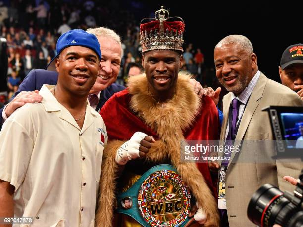 Adonis Stevenson poses for photos with his trainer SugarHill Steward and Sam Watson during the WBC light heavyweight world championship match at the...