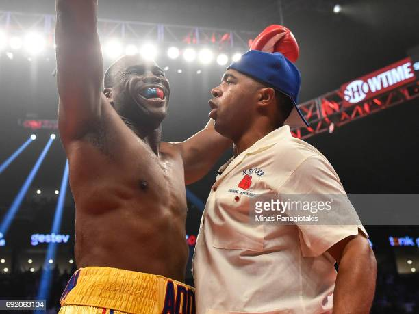 Adonis Stevenson reacts with trainer SugarHill Steward after defeating Andrzej Fonfara in the second round during the WBC light heavyweight world...
