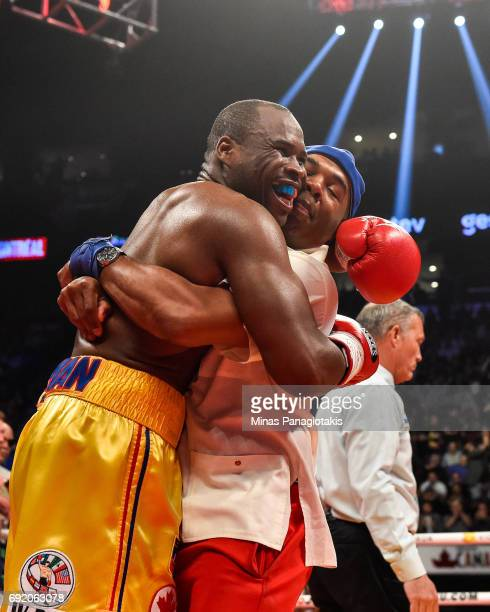 Adonis Stevenson reacts with trainer SugarHill Steward for his victory against Andrzej Fonfara in the second round during the WBC light heavyweight...