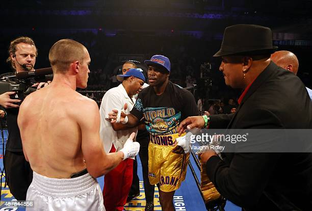 Adonis Stevenson shakes hands with Tommy Karpency following their Premier Boxing Champions bout at the Ricoh Coliseum on September 11 2015 in Toronto...