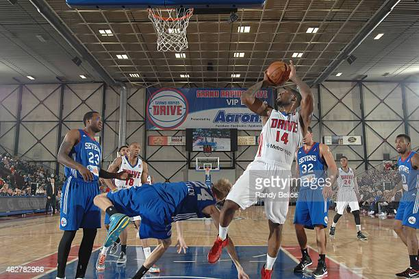 Adonis Thomas of the Grand Rapids Drive shoots over Joonas Caven of the Delaware 87ers during the NBA D-League game on January 31, 2015 at the...