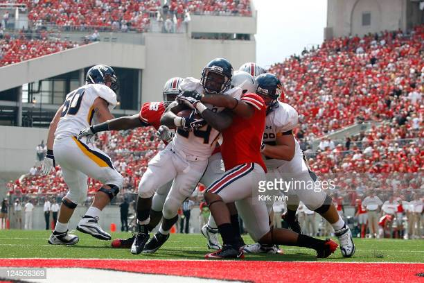 Adonis Thomas of the Toledo Rockets powers through the Ohio State Buckeyes defense to score during the third quarter on September 10, 2011 at Ohio...