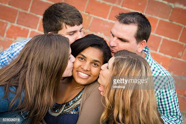 Adopted Daughter Gets Kissed by Loving Family