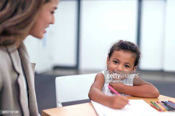 Adorable african american child coloring for a therapy session