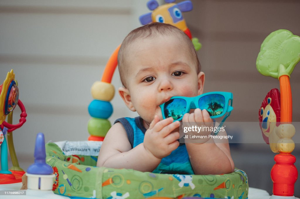 Adorable And Cute 10 Month Old Baby Boy With Fedora Hat Sits Walker Bouncer And Is Teething High Res Stock Photo Getty Images