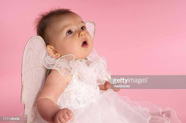 adorable baby as angel looks up in awe