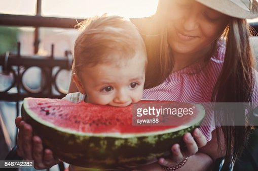 Adorable Baby Boy Biting Watermelon