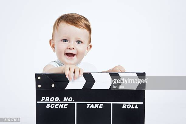 adorable baby cinema director. - film director stock pictures, royalty-free photos & images