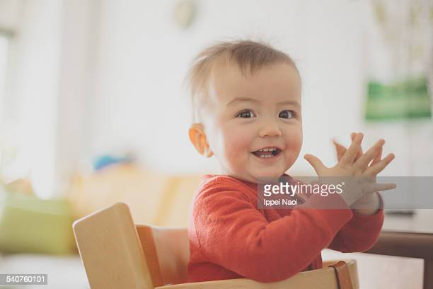 adorable baby smiling and clapping hands - ippei naoi stock pictures, royalty-free photos & images