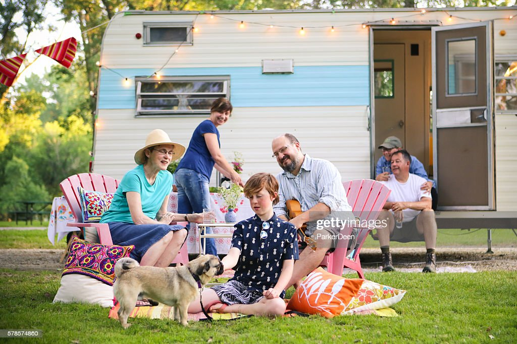 Adorable Boy and Pug Dog Vintage Camping with Friends Family : Stock-Foto