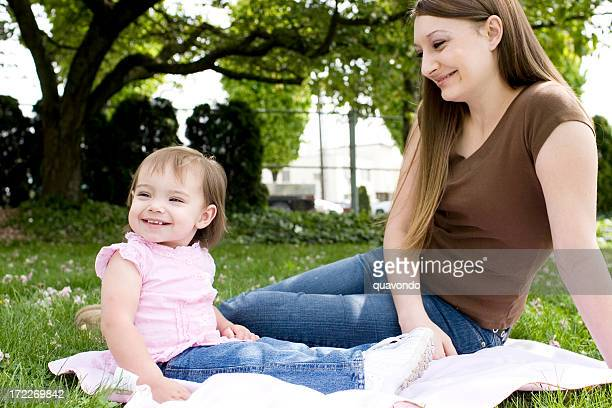 Adorable Caucasian Little Girl with Mother at Park, Copy Space