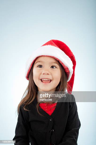 adorable cute girl with santa hat singing