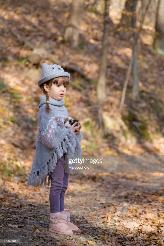 Adorable Cute Little Baby Girl With Knitted Hat And Poncho