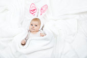 http://www.istockphoto.com/photo/adorable-cute-newborn-baby-girl-in-easter-bunny-costume-and-ears-gm909092094-250403336