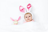http://www.istockphoto.com/photo/adorable-cute-newborn-baby-girl-in-easter-bunny-costume-and-ears-gm917717372-252465934