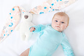 http://www.istockphoto.com/photo/adorable-cute-newborn-baby-girl-with-easter-bunny-toy-gm814304638-131713161