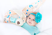 http://www.istockphoto.com/photo/adorable-cute-newborn-baby-girl-with-easter-bunny-toy-gm909089926-250403160
