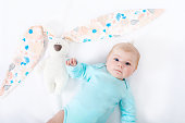 http://www.istockphoto.com/photo/adorable-cute-newborn-baby-girl-with-easter-bunny-toy-gm909092658-250403487