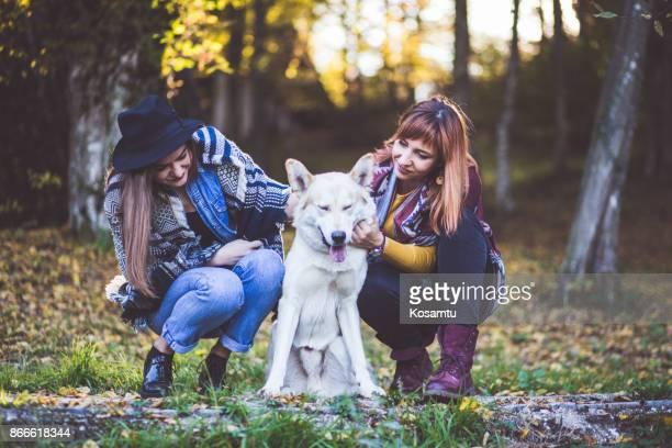 Adorable Dog Enjoying Company Of Girls