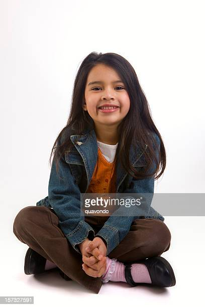 Adorable Elementary Age Girl Sitting Cross Legged, Mixed Asian Hispanic