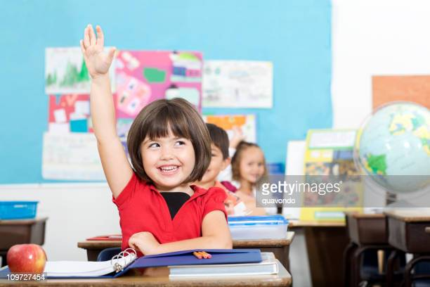 Adorable Excited Little Student Raising Hand in Elemtary Classroom