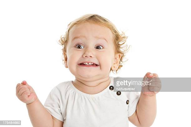 adorable expressive little girl - opwinding stockfoto's en -beelden