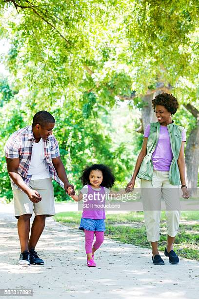 adorable family walking in the park - in the park day 3 imagens e fotografias de stock