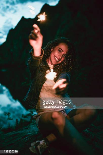 Adorable Female Celebrating Life With Lights While Camping