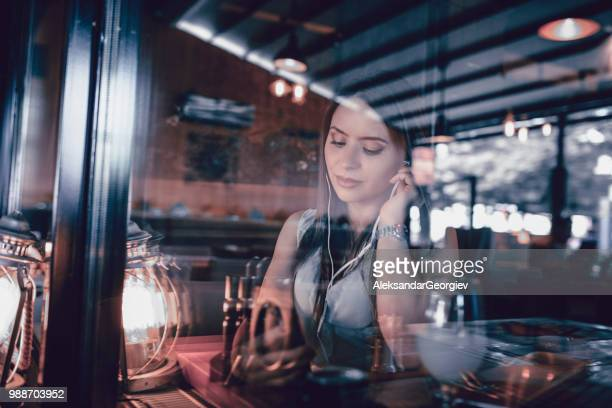 adorable female establishing video call from restaurant - mp3 juices stock photos and pictures