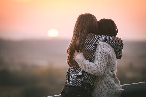 Adorable friends at golden autumn sunset. 872159376