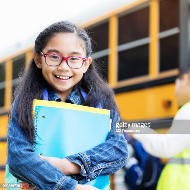 adorable girl is excited about the first day of school - school supplies stock pictures, royalty-free photos & images