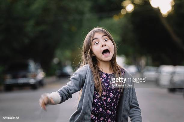 Adorable girl making funny faces