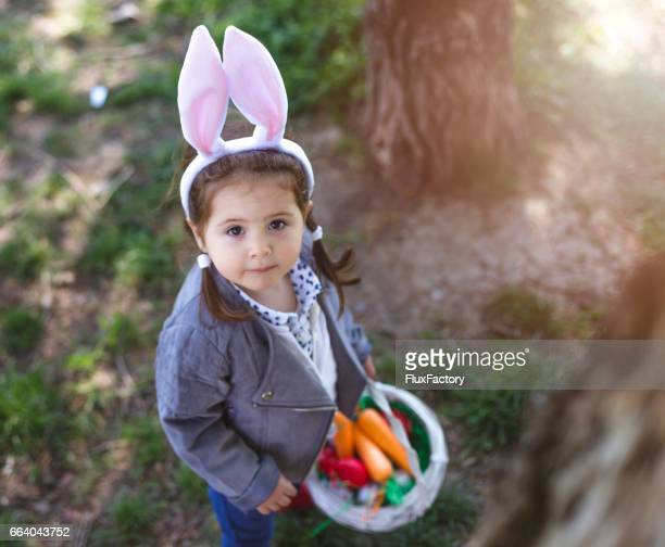 Adorable girl with bunny ears looking at the camera