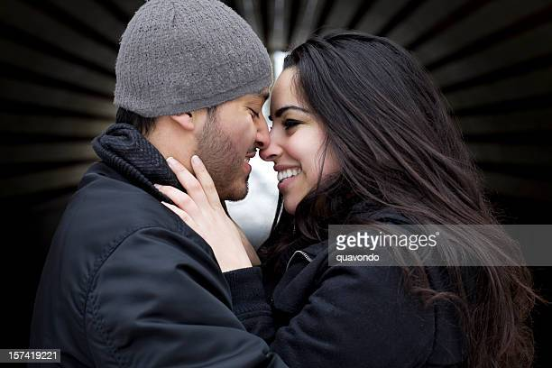 Adorable Hispanic Young Couple Portrait in Winter