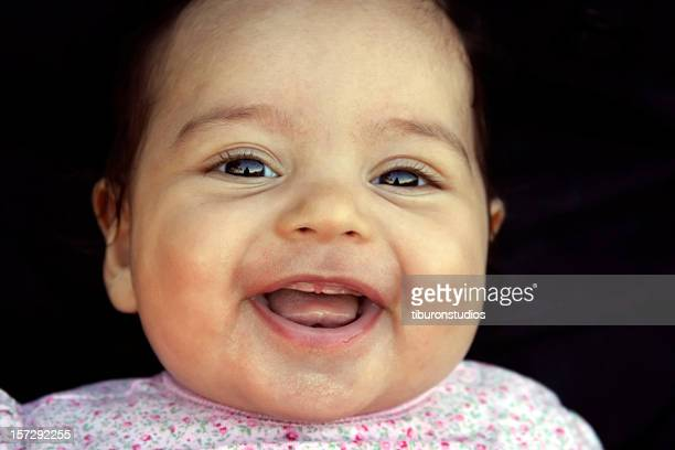 Adorable Infant's Toothless Grin