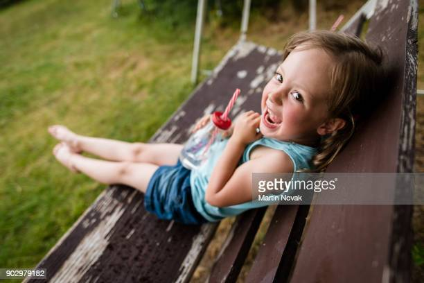 Adorable kid having fun outdoors, playtime for her.