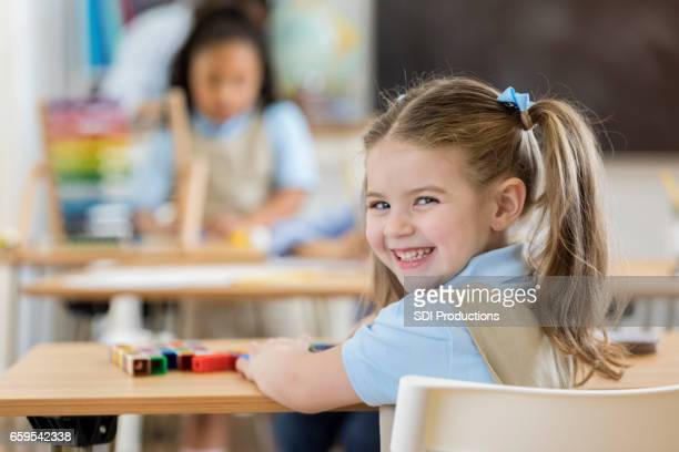 Adorable kindergartner in class